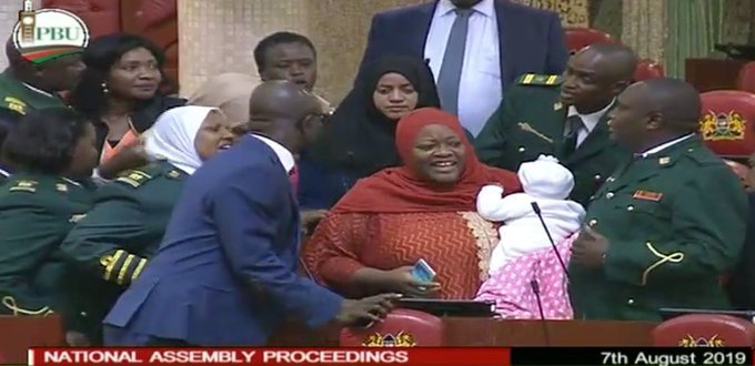 Kenyan MP carries baby to parliament